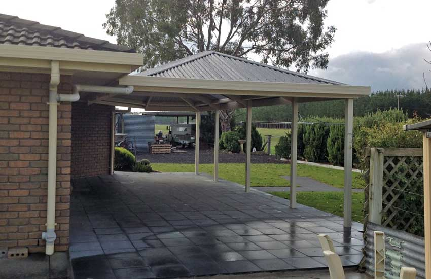 Hip roof carport with corrugated roof sheeting