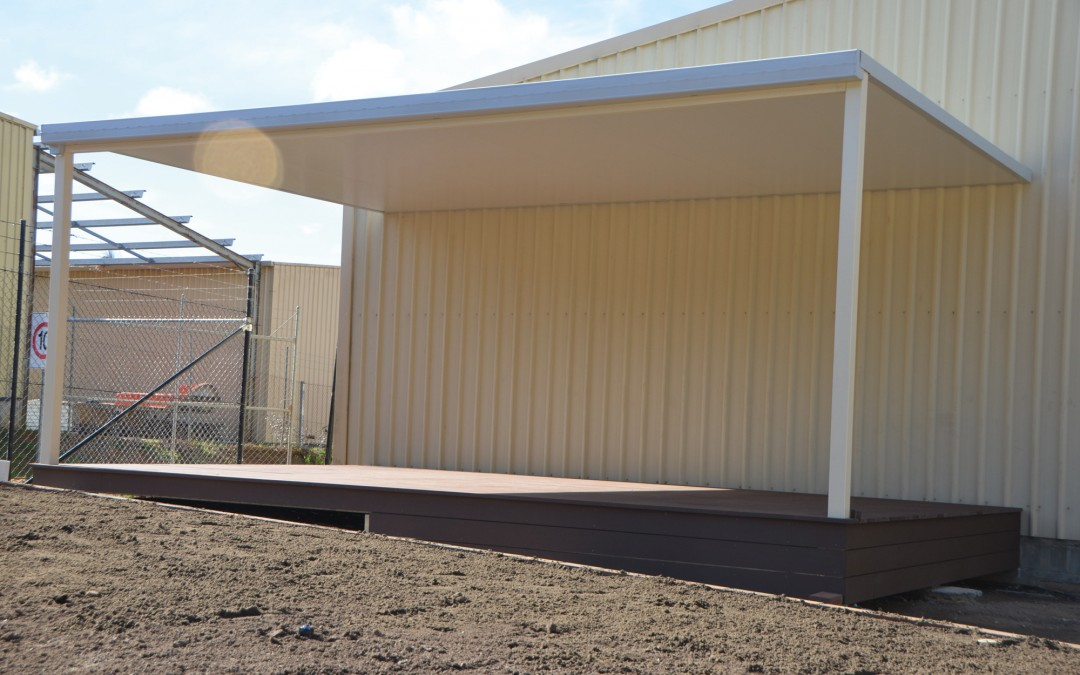 Insulated roof flat carport attached to shed