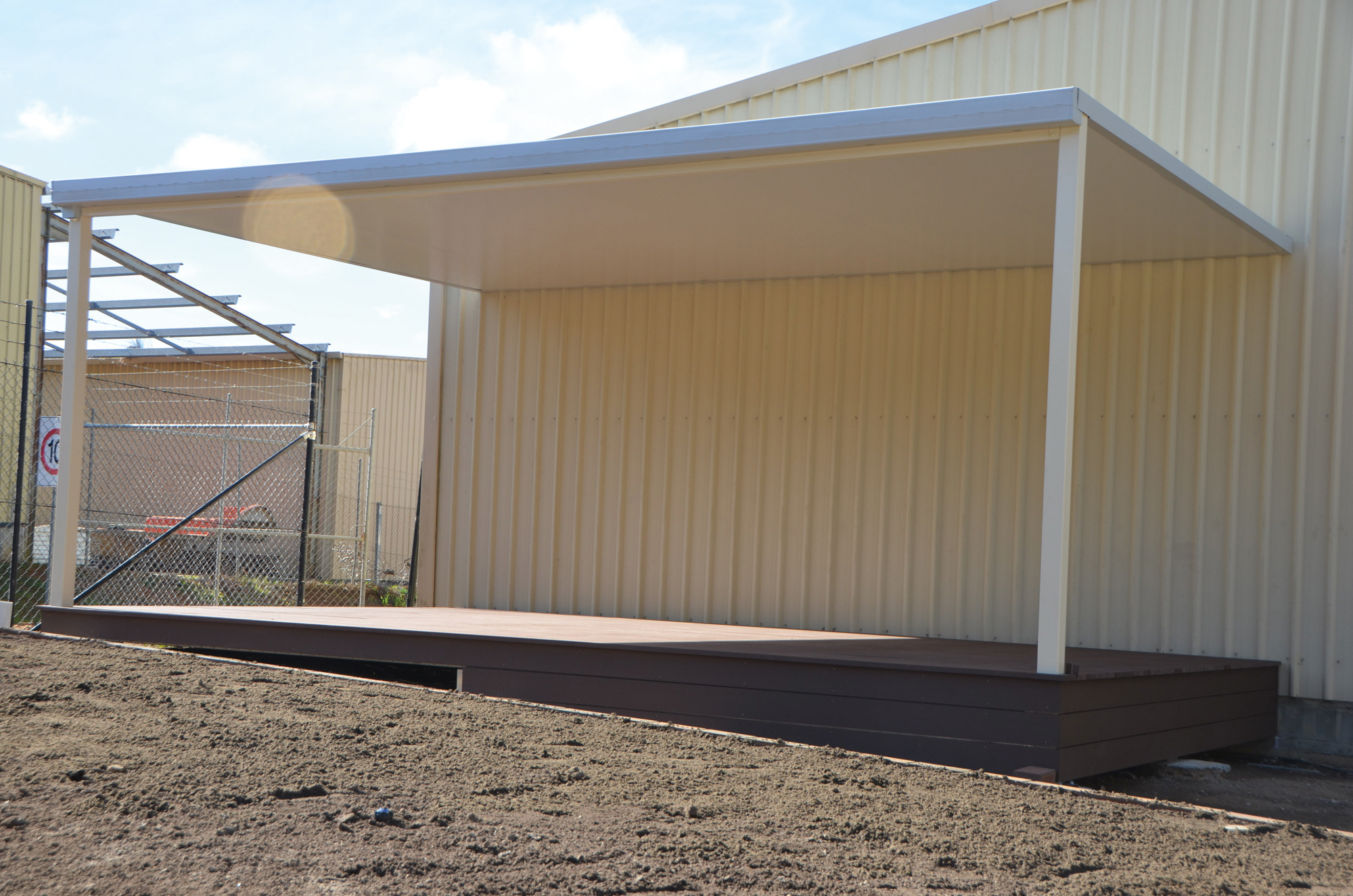 Sol home improvements gallery of steel roof styles for Shed with carport attached