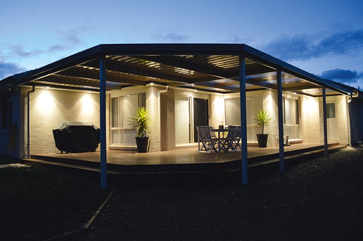 Monoclad verandah with skylights at night