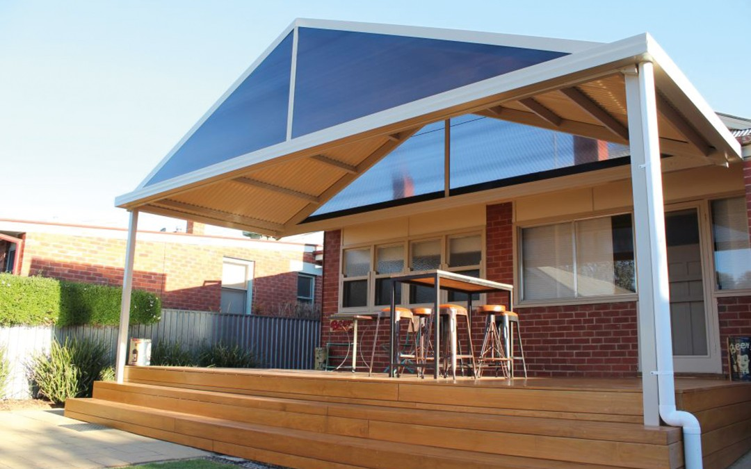 Attached gable roof awning with translucent gable infills and corrugated roof sheets